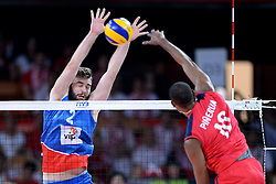 06.09.2014, Jahrhunderthalle, Breslau, POL, Venezuela vs Serbien, Gruppe A, im Bild UROS KOVACEVIC (L), KERVIN PINERUA (P) // during the FIVB Volleyball Men's World Championships Pool A Match beween Uenezuela and Serbia at the Jahrhunderthalle in Breslau, Poland on 2014/09/06. <br /> <br /> ***NETHERLANDS ONLY***