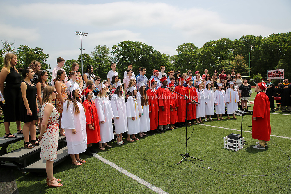 (6/2/19, MILFORD, MA) The Milford High chorus sings during graduation at Milford High School on Sunday. [Daily News and Wicked Local Photo/Dan Holmes]