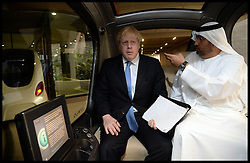 The London Mayor Boris Johnson In a driverless electric Car with the  Sultan Al Jaber, CEO of Masdar and Minister of State for Energ as he tours Masdar City . The Mayor is on a 2 day tour of the UAE, Monday April 15, 2013. Photo By Andrew Parsons / i-Images
