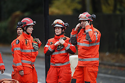 © Licensed to London News Pictures. 09/11/2016. London, UK. A Firebrigade urban search & rescue group are seen near where a tram has derailed at Sandlilands tram station in Croydon, Greater London. Dozens of people are believed to be injured with some trapped. It is now being reported that there are a number of fatalities. Photo credit: Peter Macdiarmid/LNP