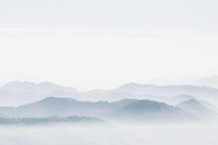 Fog shrouds multiple valleys and ridgelines in the Gros Ventre Mountains of Wyoming.