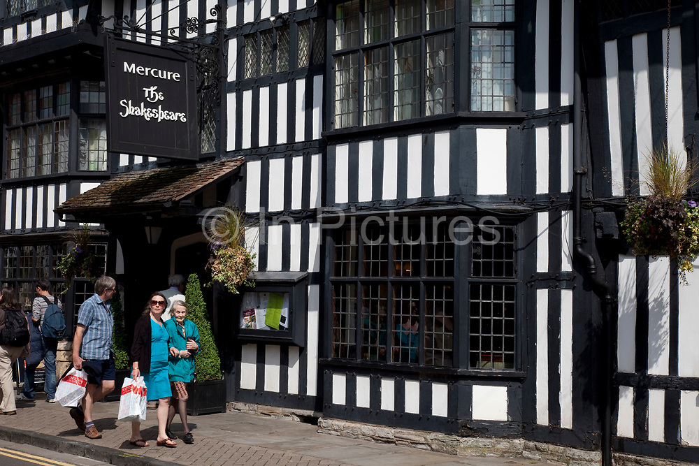 Tudor building now a hotel, The Shakespeare in Stratford upon Avon, a small market town in the county of Warwickshire in central England. The Tudor architectural style is the final development of medieval architecture during the Tudor period (1485–1603). The town is a popular tourist destination owing to its status as birthplace of the playwright and poet William Shakespeare, receiving about three million visitors a year from all over the world.