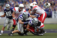 Illinois State running back Pierre Rembert (5) has his helmet pop off, after getting hammered by Kansas State defenders Ian Campbell (98) and Steven Cline (99) at Bill Snyder Family Stadium in Manhattan, Kansas, September 2, 2006.  The Wildcats beat the Redbirds 24-23.