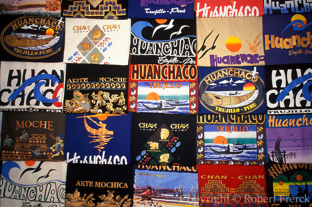 PERU, NORTH COAST, LIFESTYLE T-shirts for sale at vendor stall on the beach at Huanchaco near Trujillo