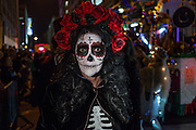 New York, NY - October 31, 2015. La Calavera Catarina with a coronet of red roses.