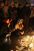 """Protesters use candles and pens to mourn the dead journalists and cartoonists of Charlie Hebdo. A massive public demonstration took place in Place de la Republique, in central Paris, France; the evening after armed gunmen attacked the offices of Charlie Hebdo, killing twelve people, including the editor and celebrated cartoonists; four more are in critical condition. It is the dealiest terror attack in France for over fifty years. Charlie Hebdo is a satirical publication well known for its political cartoons. <br /><br />As a solidarity actions with the deaths at Charlie Hebdo many placards read """"Je suis Charlie"""" translating as """"I am Charlie (Hebdo)"""". Demonstrators held aloft pens, brushes and crayons, symbolizing the profession of journalists and cartoonists who were killed. Many pens were placed in a shrine with candles in the square"""