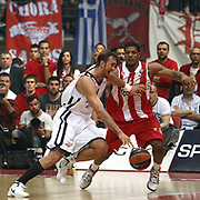 Anadolu Efes's Semih Erden (L) during their Turkish Airlines Euroleague Basketball playoffs Game 5 Olympiacos between Anadolu Efes at SEF Indoor Hall in Piraeus, in Greece, Friday, April 26, 2013. Photo by TURKPIX
