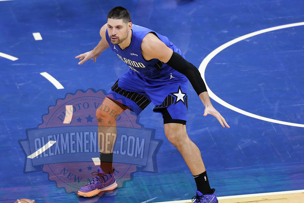 ORLANDO, FL - FEBRUARY 19:  Nikola Vucevic #9 of the Orlando Magic plays against the Golden State Warriors during the first half at Amway Center on February 19, 2021 in Orlando, Florida. NOTE TO USER: User expressly acknowledges and agrees that, by downloading and or using this photograph, User is consenting to the terms and conditions of the Getty Images License Agreement. (Photo by Alex Menendez/Getty Images)*** Local Caption *** Nikola Vucevic