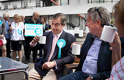 © Licensed to London News Pictures. 18/05/2019. Canvey Island, UK. Brexit Party leader Nigel Farage drinks tea with supporters as he campaigns for the European Elections in Canvey Island, Essex. The European Elections are being held on Thursday 23rd May. Photo credit: Peter Macdiarmid/LNP