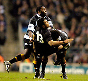 Twickenham, Surrey, 4th December 2004, The Gartmore Challenge Rugby Cup,  Barbarians vs New Zealand, RFU Stadium, England,<br /> Casey Laulala, is upended in the  tackle by, Lote Tuqiri, and [left] Gcobani Bobo <br /> <br /> [Mandatory Credit; Peter Spurrier/Intersport Images]