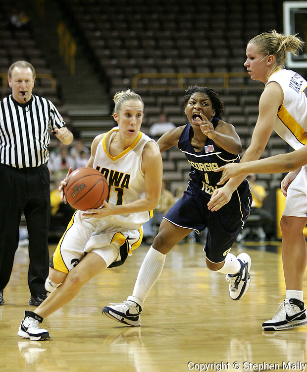 28 NOVEMBER 2007: Iowa guard Kristi Smith (11) drives to the basket while being followed by Georgia Tech guard Jacqua Williams (1) in the first half of Georgia Tech's 76-57 win over Iowa in the Big Ten/ACC Challenge at Carver-Hawkeye Arena in Iowa City, Iowa on November 28, 2007.