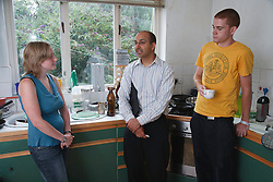Social Worker in discussion with young couple in their own home.