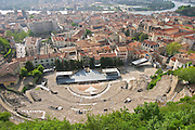 A view from above of the roman theatre amphitheatre in Vienne. The town behind it and the river Rhone in the background. The theatre was built in the 4th century and is today used for concerts and other events  Vienne, Isère Isere, France, Europe