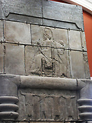 Plaster cast from Persepolis.  The image opposite is made from part of one side of a huge doorway to a palace built between 470-450 BC.  It shows the king sitting on a throne and holding a sceptre and lotus flower.  An attendant stands behind and above is a richly decorated canpy.