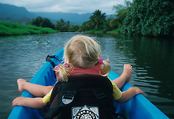 United States, Hawaii, Kauai, girl (age 3) kayaking on Hanalei River.  MR