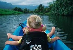 United States, Hawaii, Kauai, girl (age 3) kayaking on Hanalei River.  MR