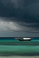 Dhow boat under stormy skies, Zanzibar