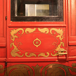 Red stage-coach type carriage is on display at the Pennsylvania State Museum in Harrisburg.
