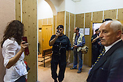 17/08/2012, Moscow, Russia..A special forces police officer takes photos on his mobile phone outside the courtroom as Maria Alyokhina, Yekaterina Samutsevich and Nadezhda Tolokonnikova of punk band Pussy Riot are sentenced to two years in prison for their performance in the Christ The Saviour Cathedral.