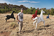 """Artist Kevin Box stands in front of his work """"Painted Ponies"""" on the grounds at Box Studio on Saturday, July 18, 2020."""