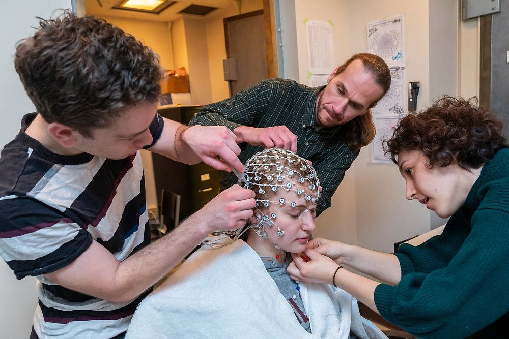Shiri Spitz, lab manager and lab technician, along with Bruce C. Hansen, Associate Professor of Psychology, perform an electroencephalogram on a student April 12, 2019.<br /> Mark DiOrio / Colgate University