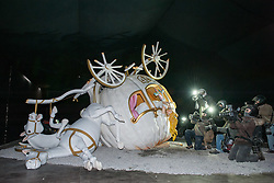 © Licensed to London News Pictures. 22/08/2015. Weston-super-Mare, North Somerset, UK.  The crashed Cinderella coach surrounded by photographers, on the first main day of BANKSY's Dismaland show at the old Tropicana on Weston seafront, when the event is open to the general public. Photo credit : Simon Chapman/LNP