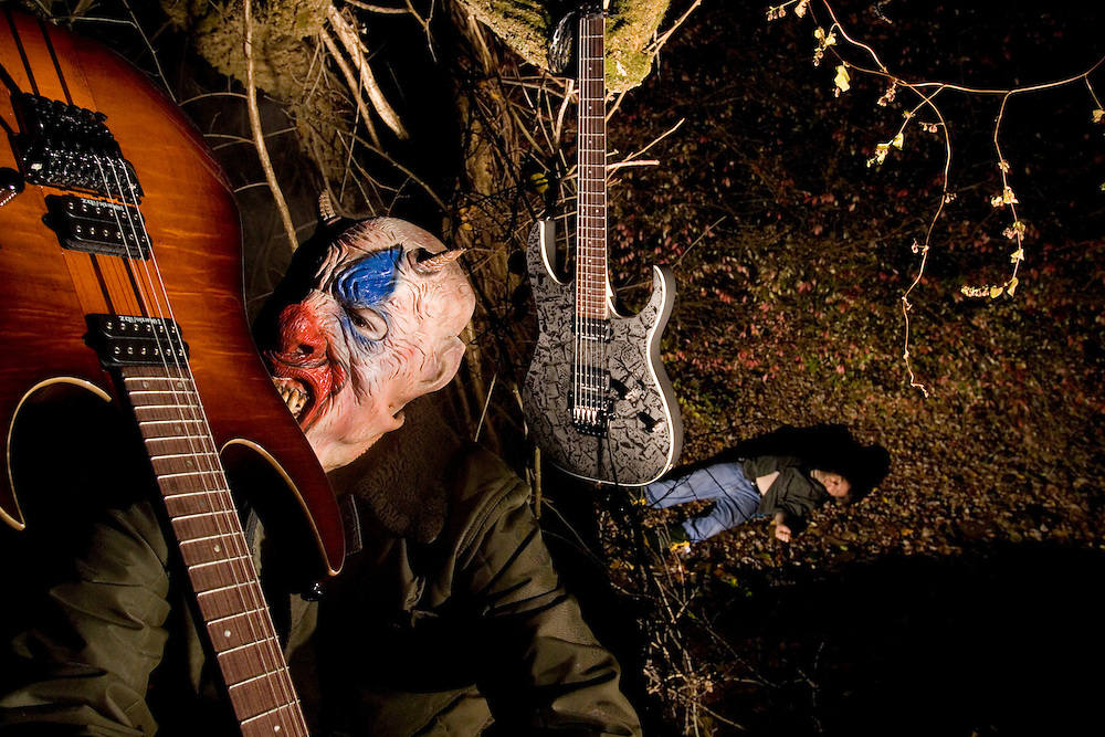 """Scene from an imaginary film, """"The Ax Murderer"""". This serial killer cavorts in the dark of night while one of his victims lies in the background. Shot for Ibanez Electric guitars."""
