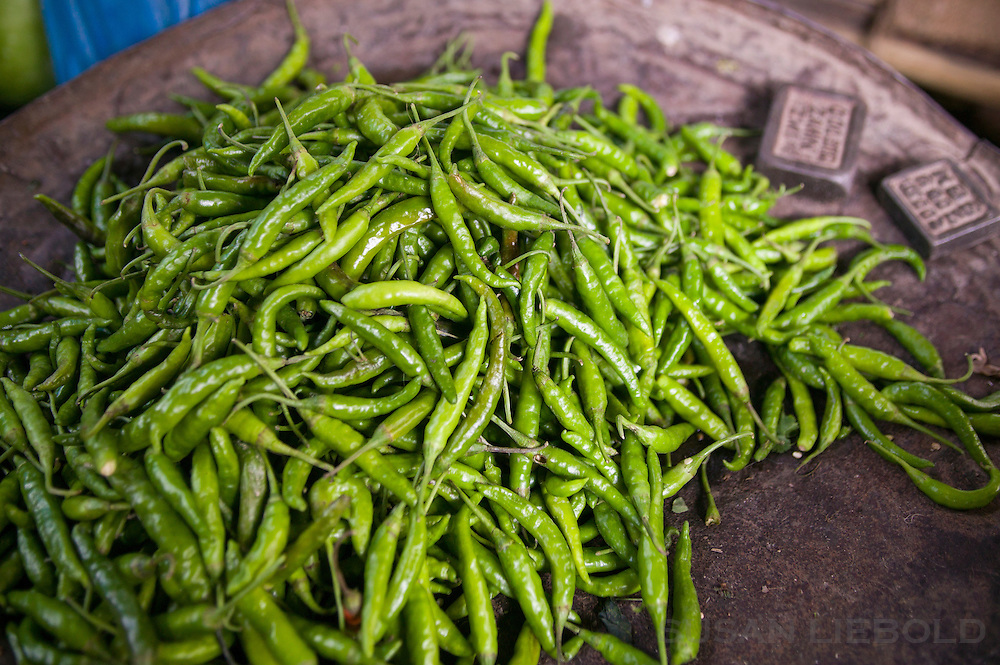 Green hot peppers for sale at a local market in Dhaka Bangladesh.