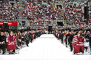 Rows of graduates await the procession during the University of Wisconsin-Madison commencement ceremony at Camp Randall Stadium, Saturday, May 17, 2014.