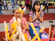 08 JANUARY 2015 - BANGKOK, THAILAND: Women pray and meditate at an altar on Sanam Luang in Bangkok. Buddhist in Bangkok have a chance to meditate in front of seven large statues of revered Buddhist monks and worship a hair relic of the Buddha at a series of altars on Sanam Luang near the Grand Palace in Bangkok.    PHOTO BY JACK KURTZ