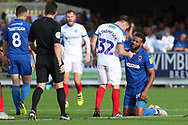 Portsmouth midfielder Ben Thompson (32) pointing at AFC Wimbledon midfielder Tom Soares (19) during the EFL Sky Bet League 1 match between AFC Wimbledon and Portsmouth at the Cherry Red Records Stadium, Kingston, England on 13 October 2018.