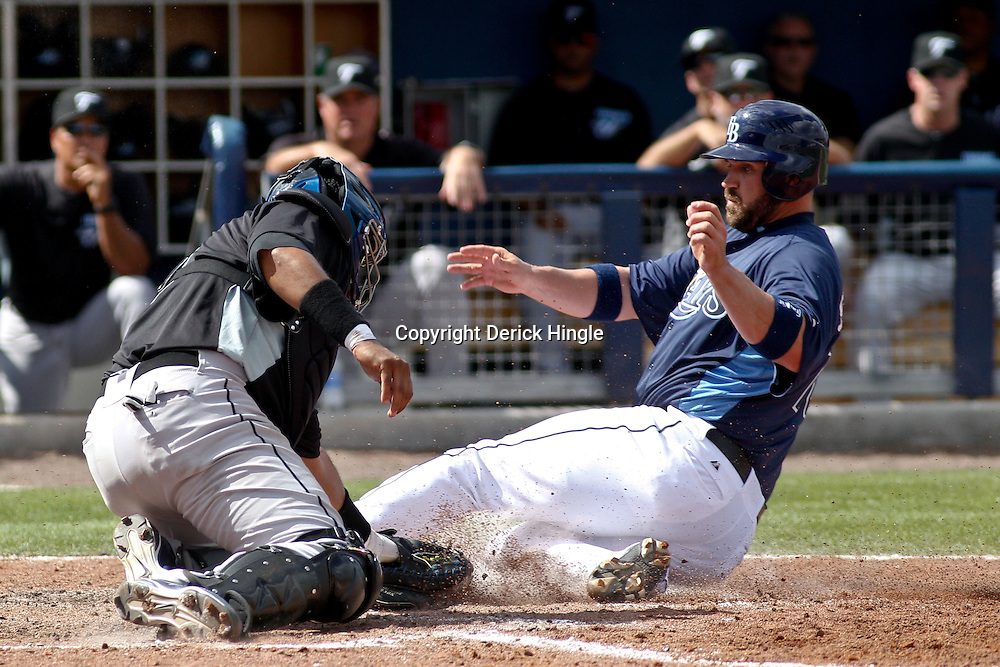 March 8, 2011; Port Charlotte, FL, USA; Tampa Bay Rays catcher Kelly Shoppach (10) is tagged out by Toronto Blue Jays catcher Jose Molina (8) at home plate during a spring training exhibition game at Charlotte Sports Park.   Mandatory Credit: Derick E. Hingle