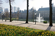 """View from Lange Vijverberg to the Hofvijver and government buildings """"Het Binnenhof"""" in the center of The Hague, Netherlands during early spring season"""