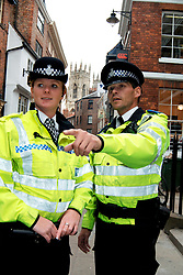 Policeman & Community Support Officer patrol streets of York; Yorkshire UK