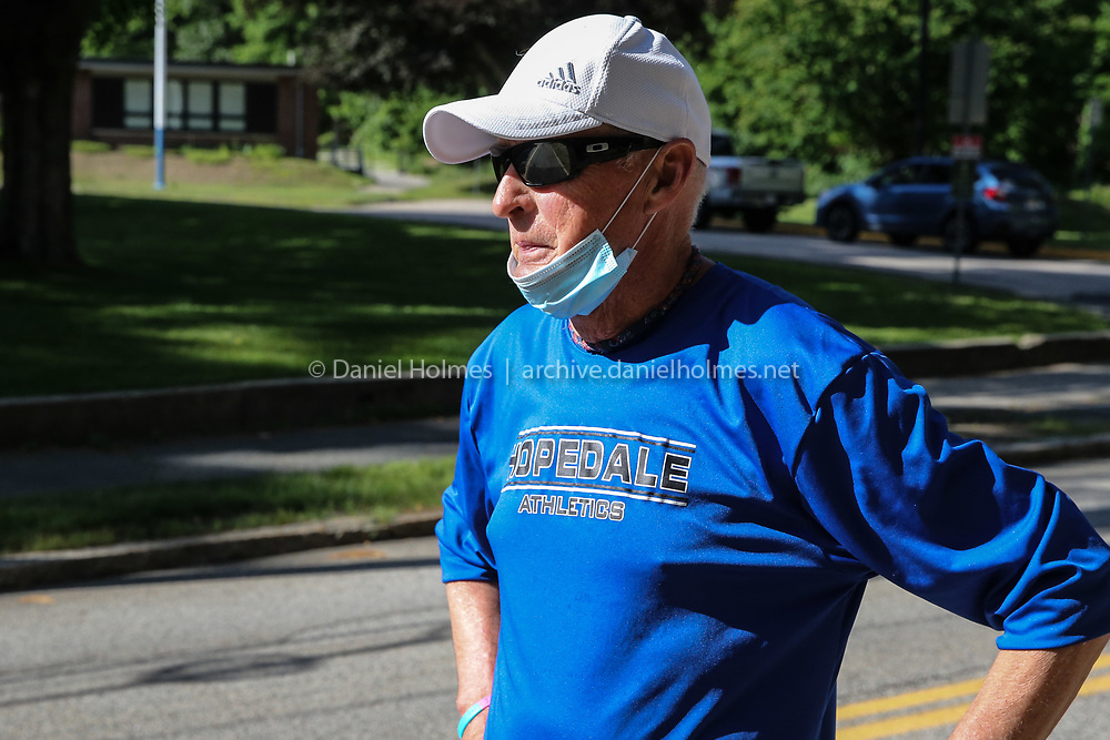 Hopedale running coach, Joe Drugan, 76, gets read to run the Crush Corona 5K starting at Hopedale Memorial Elementary School on Jun. 12, 2020. The 5K was setup to honor and celebrate those people over 70 who have suffered or lost their lives during the coronavirus pandemic. [Daily News and Wicked Local Photo/Dan Holmes]