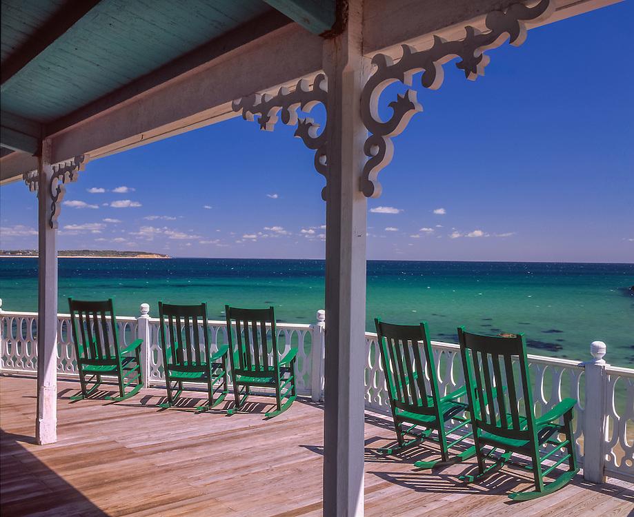 Row of green porch rockers & Atlantic ocean view, Block Island, RI