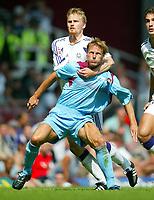 Photo: Scott Heavey, Digitalsport<br /> West Ham v RSC Anderlecht. Pre-season Friendly. 31/07/2004.<br /> Teddy Sheringham is pulled back by Hannu Tihinen