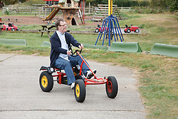 Man with learning disability riding go-carts on visit to farm