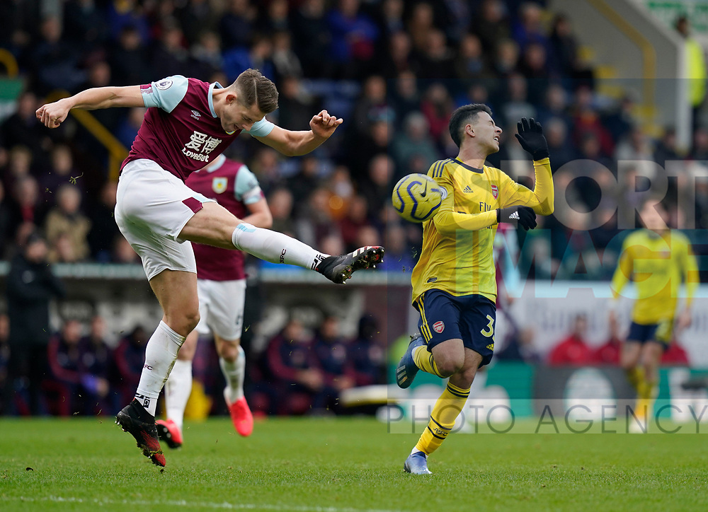 James Tarkowski of Burnley clears the ball under pressure from Gabriel Martinelli of Arsenalduring the Premier League match at Turf Moor, Burnley. Picture date: 2nd February 2020. Picture credit should read: Andrew Yates/Sportimage