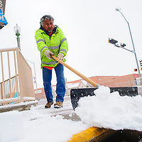 020714  Adron Gardner/Independent<br /> <br /> City of Gallup employee Jerry Pinto shovels snow from the corner of Historic Route 66 and Third Street in Gallup Friday.