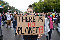 "25 SEP 2020, BERLIN/GERMANY:<br /> Junge Frau mit Schild ""There is no Planet B"", Fridays for Future Demonstration fuer Massnahmen gegen den Klimawandel, Brandenburger Tor, Strasse des 17. Juni<br /> IMAGE: 20200925-01-012<br /> KEYWORDS: Protest, Demonstrant, Demonstranten, Demonstratin, Schueler, Schüler, Klimakatastrophe, FFF, Mundschutz, Mund-Nase-Schutz, Abstand"