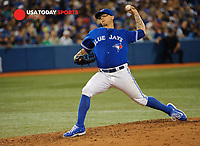 Jul 19, 2014; Toronto, Ontario, CAN; Toronto Blue Jays relief pitcher Brett Cecil in 8th innings who gave up only run in Toronto Blue Jays at Rogers Centre. Toronto won 4 - 1 Mandatory Credit: Peter Llewellyn-USA TODAY Sports