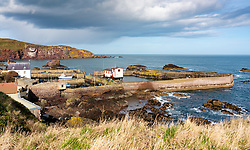 View of small fishing village and harbour of St Abbs on North Sea coast in Scottish Borders, Scotland, UK