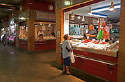 Fishmonger stall in historic market building in Triana, Seville, Spain