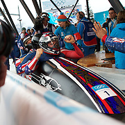 Winter Olympics, Vancouver, 2010.The USA-1 team of Steven Holcomb (front), Justin Olsen, Steve Mesler and Curtis Tomasezicz win the Gold Medal in the Bobsleigh Four-man at The Whistler Sliding Centre, Whistler, during the Vancouver Winter Olympics. 27th February 2010. Photo Tim Clayton