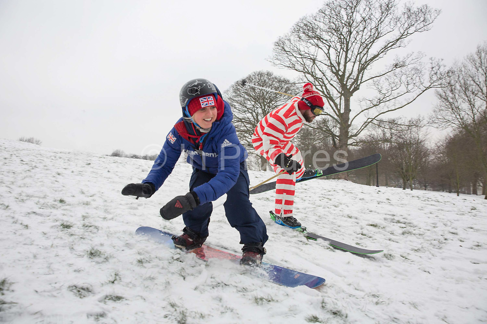 Two days after returning from the Winter Olympics in Pyeongchang, South Korea, Team GB freestyle snowboarder Aimee Fuller joins the BBC at Primrose Hill for a spot of UK snowboarding on 1st March 2018 in Primrose Hill, North London in the United Kingdom. A cold front from Russia brings snow and freezing conditions across the UK, dubbed the 'Beast from the East'.