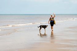 Aileen and Wallce enjoying the sand on Mapleton dog friendly beach<br /> <br />  02 August 2018<br />  Copyright Paul David Drabble<br />  www.pauldaviddrabble.co.uk