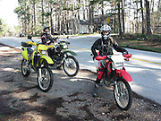 Kay Pratt on Honda and Connie Hamilton on green Kawasaki during dual sport ride in NW Arkansas