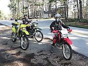 Kay Pratt on Honda and Connie Hamilton on green Kawasaki during dual sport ride in NW Arkansas