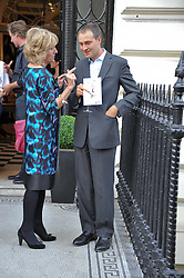 ANNABEL ELLIOT and BEN GOLDSMITH at a party to celebrate the 60th birthday of Mark Shand and the 50th birthday of Tara the elephant held at 29 Portland Place, London on 25th May 2011.